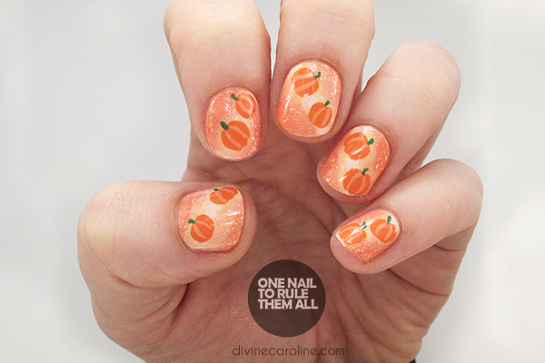 If you love Halloween, these pumpkin-inspired Halloween nails are for you.  By combining a gradient design, your choice of orange or gold glitter, ... - A Glittery Pumpkin-Inspired Nail Design For Halloween Or All Fall