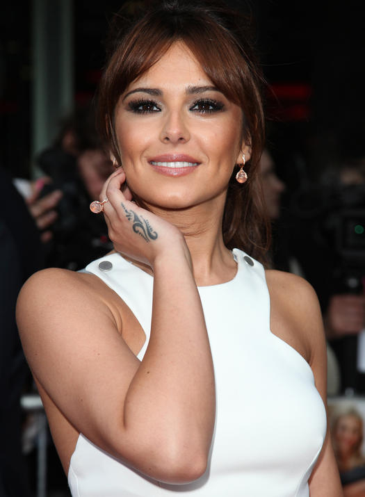 Celebrity tattoo gallery the good the bad and the wtf for Cheryl cole tattoo removal