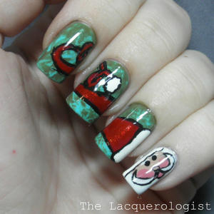 12 Festive Christmas Nail Art Designs for the Holiday Season