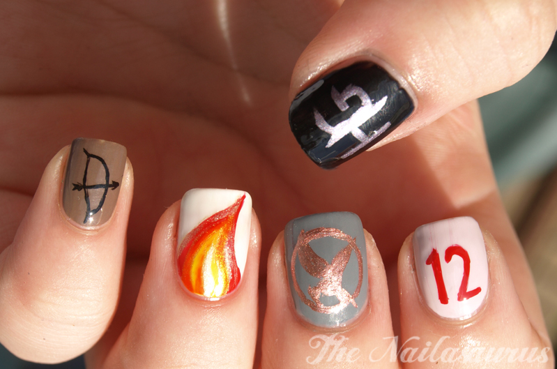This Hunger Games nail art by I Have a Cupcake was based on the book cover  art, and features a circular design on a grey background and a standout  accent ... - 11 Hunger Games Nail Designs To Wear To The Mockingjay Part 2